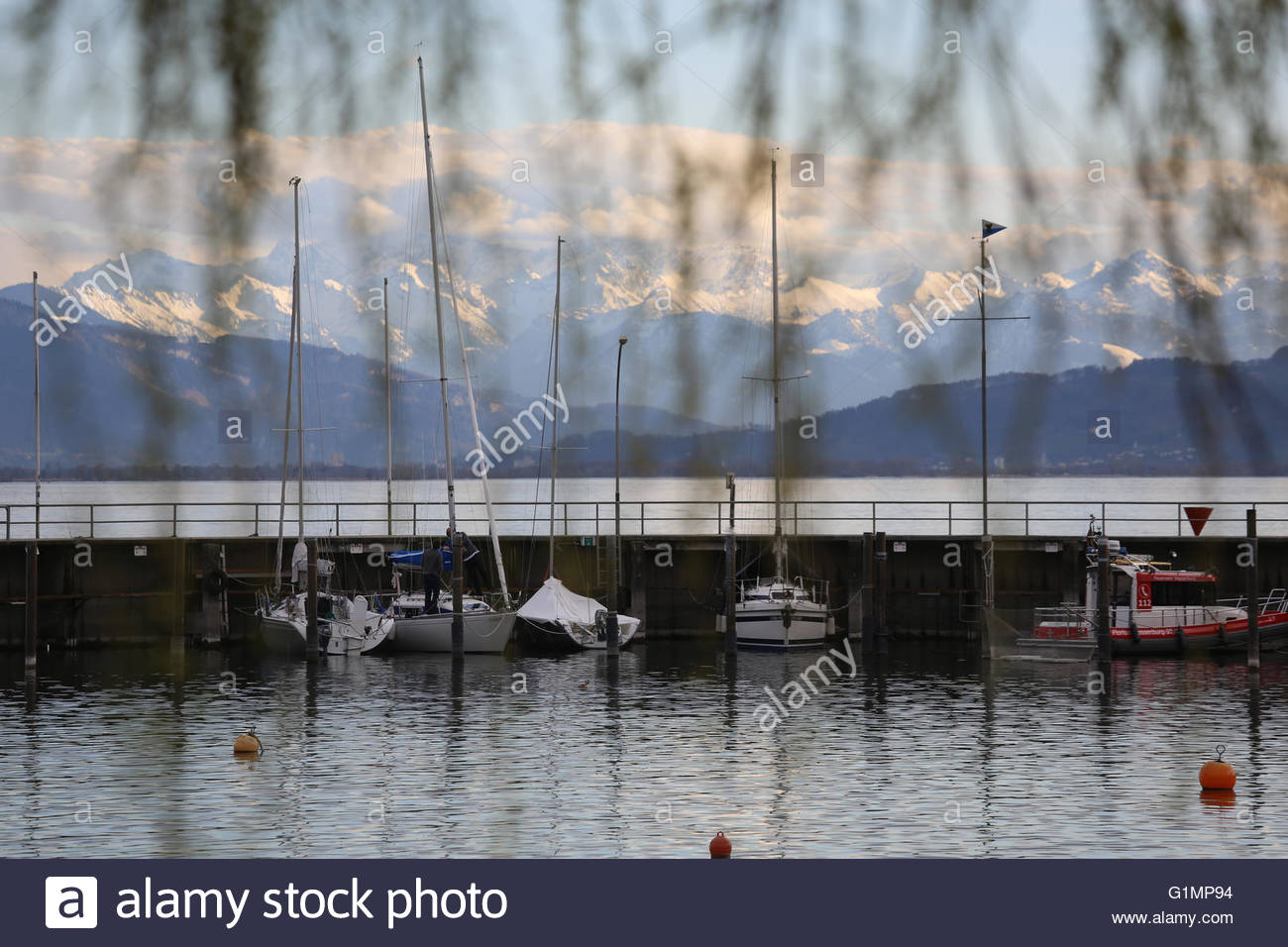 A shot of the Alps near Lindau on Lake Constance. - Stock Image