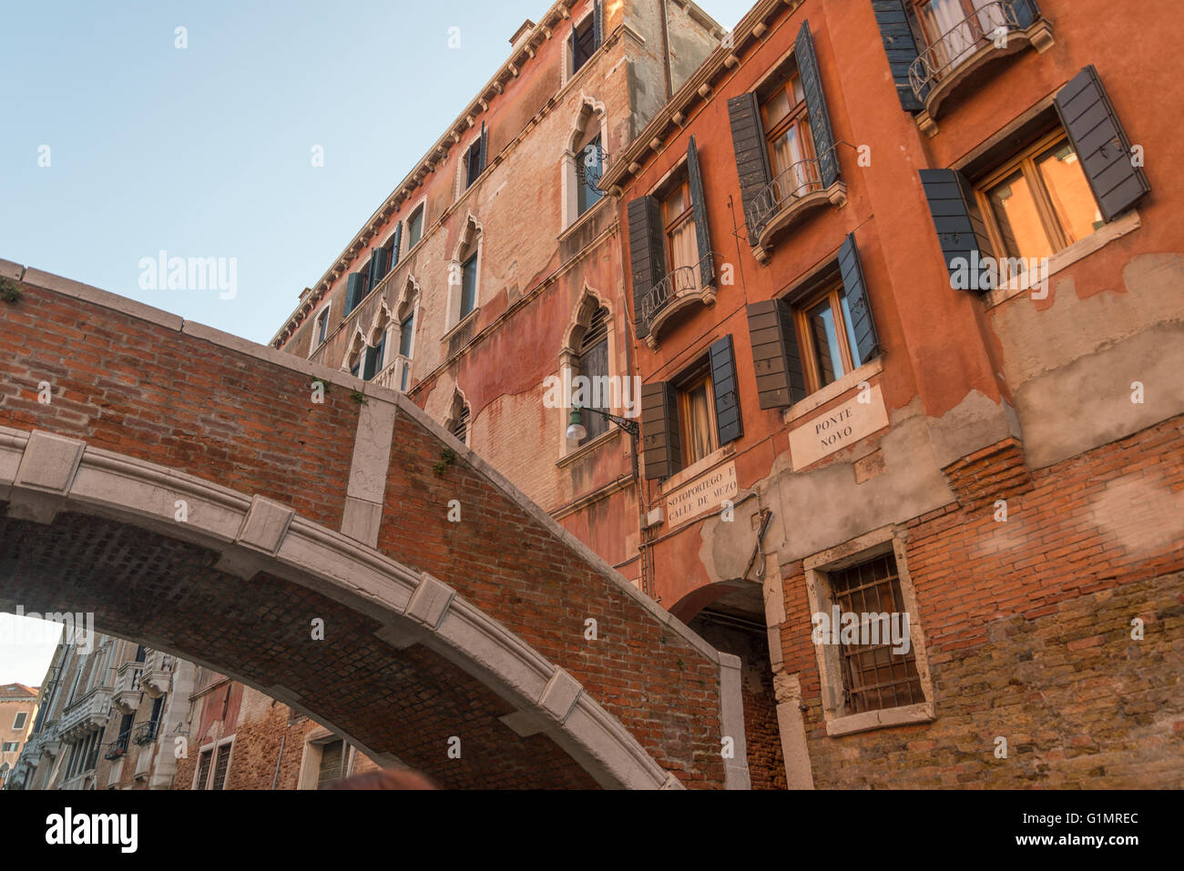 old houses and bridge on a small canal behind Riva degli Schiavoni, Venice Stock Photo