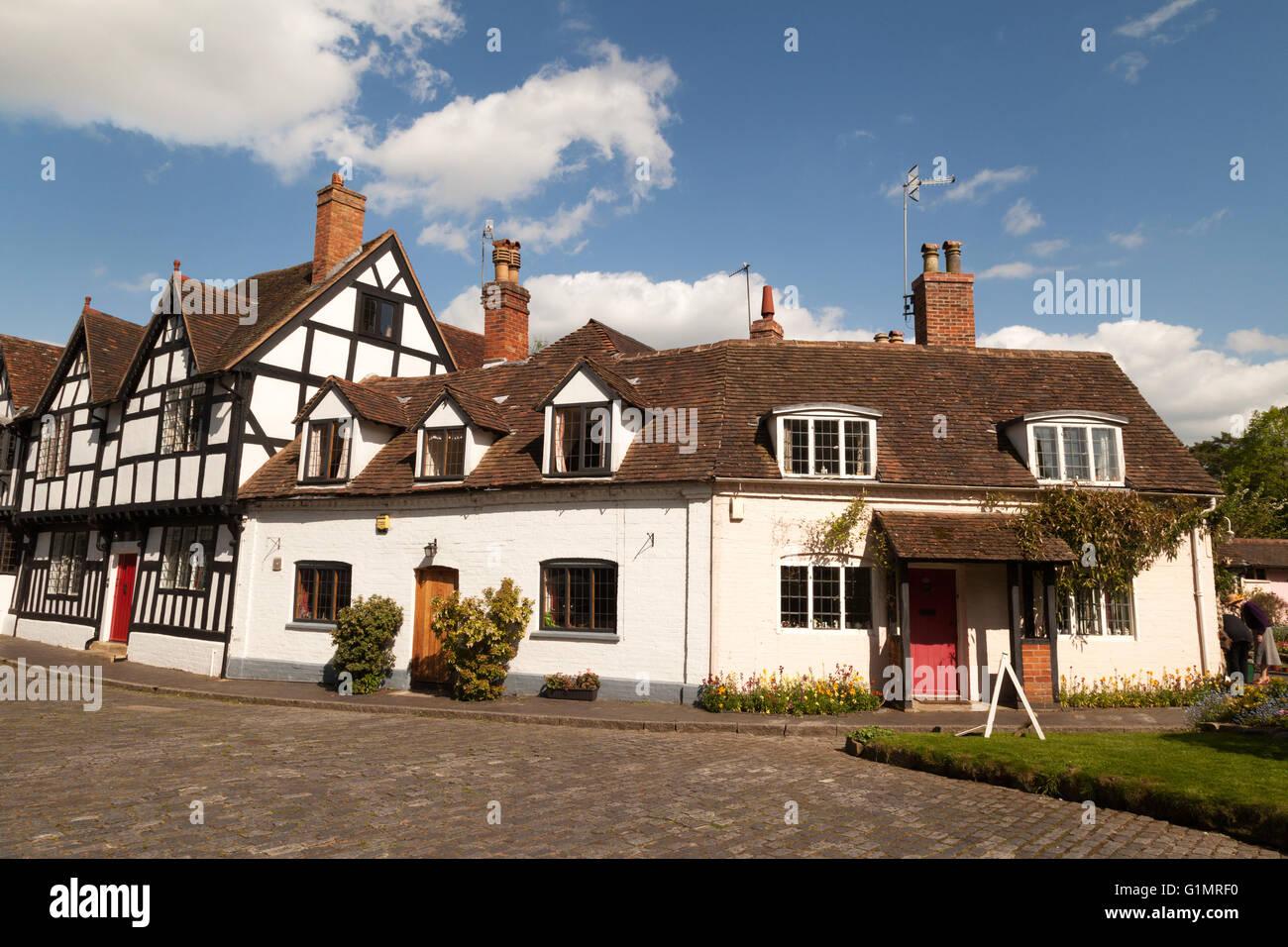 Tudor half timbered black and white medieval houses, Mill Street, Warwick, Warwickshire UK - Stock Image