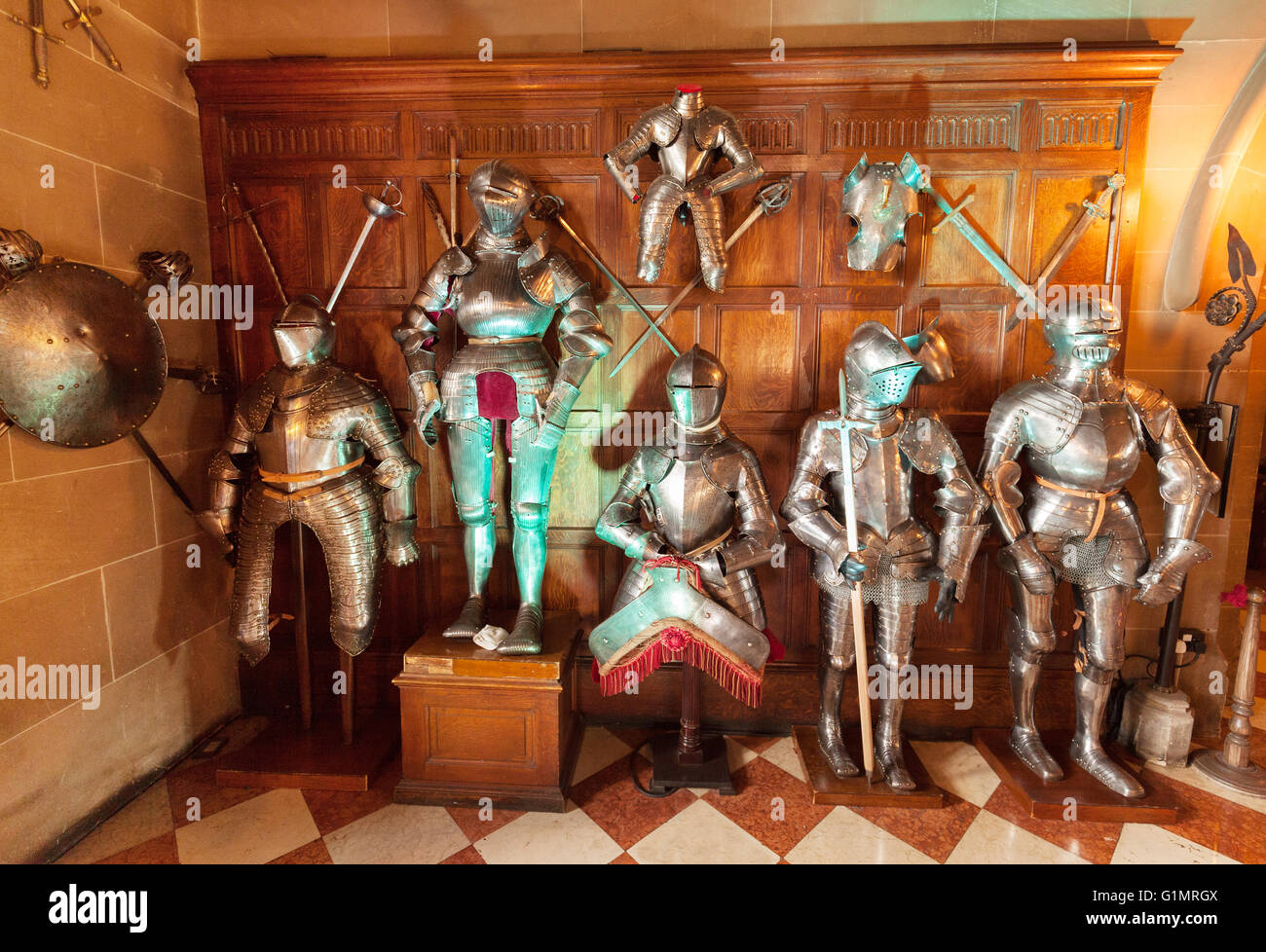 Medieval suits of armour on display, Warwick castle interior, Warwick, Warwickshire England UK - Stock Image