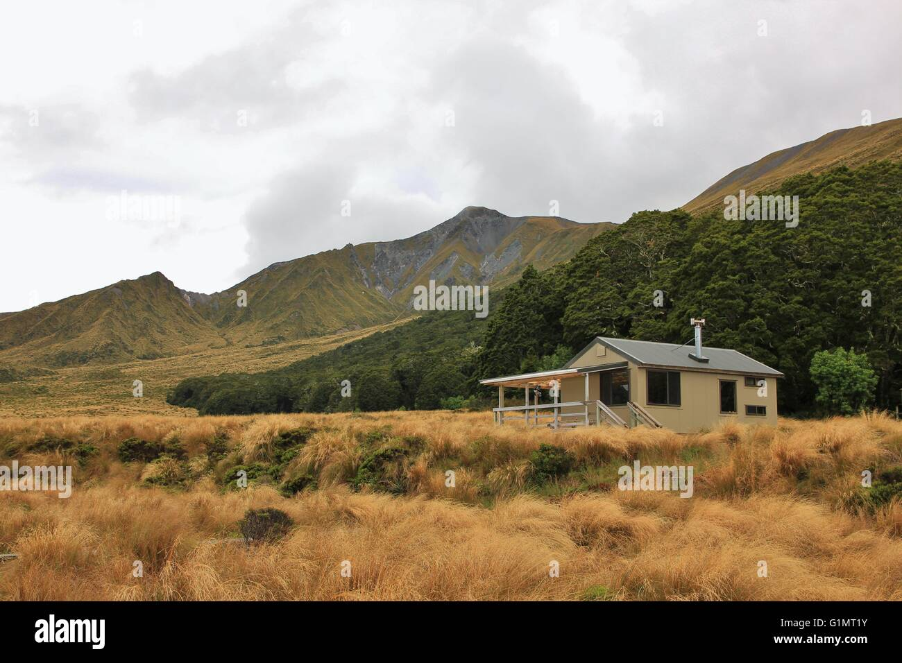 Public back country hut in the Fiordland National Park. Tramping destination in New Zealand. - Stock Image