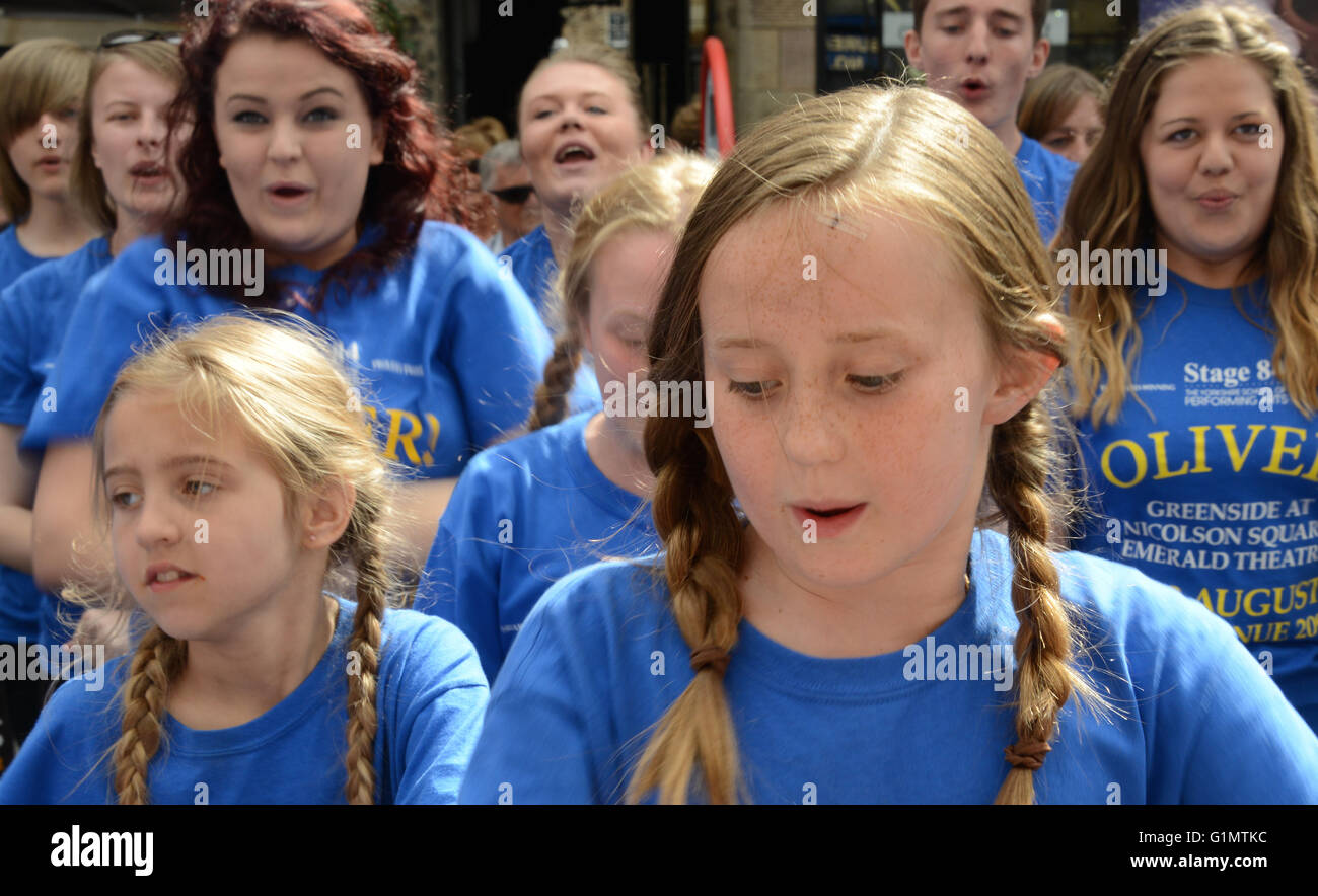 Schoolchildren performing songs from Oliver - Stock Image