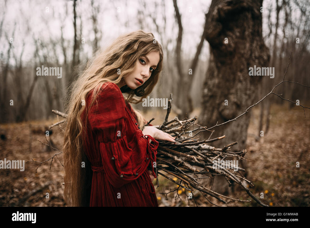 Witch in forest - Stock Image