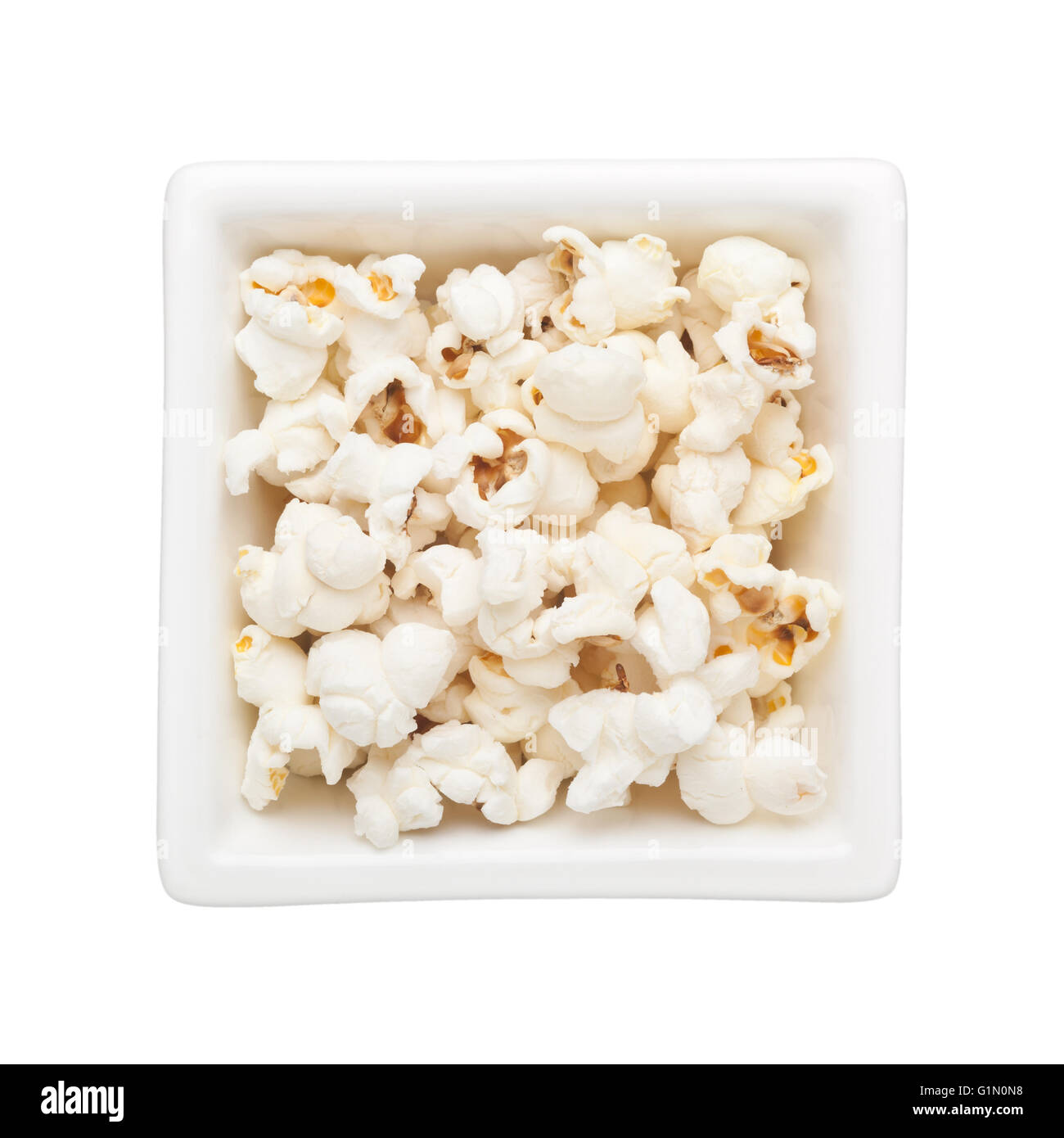 Plain popcorn in a square bowl isolated on white background - Stock Image