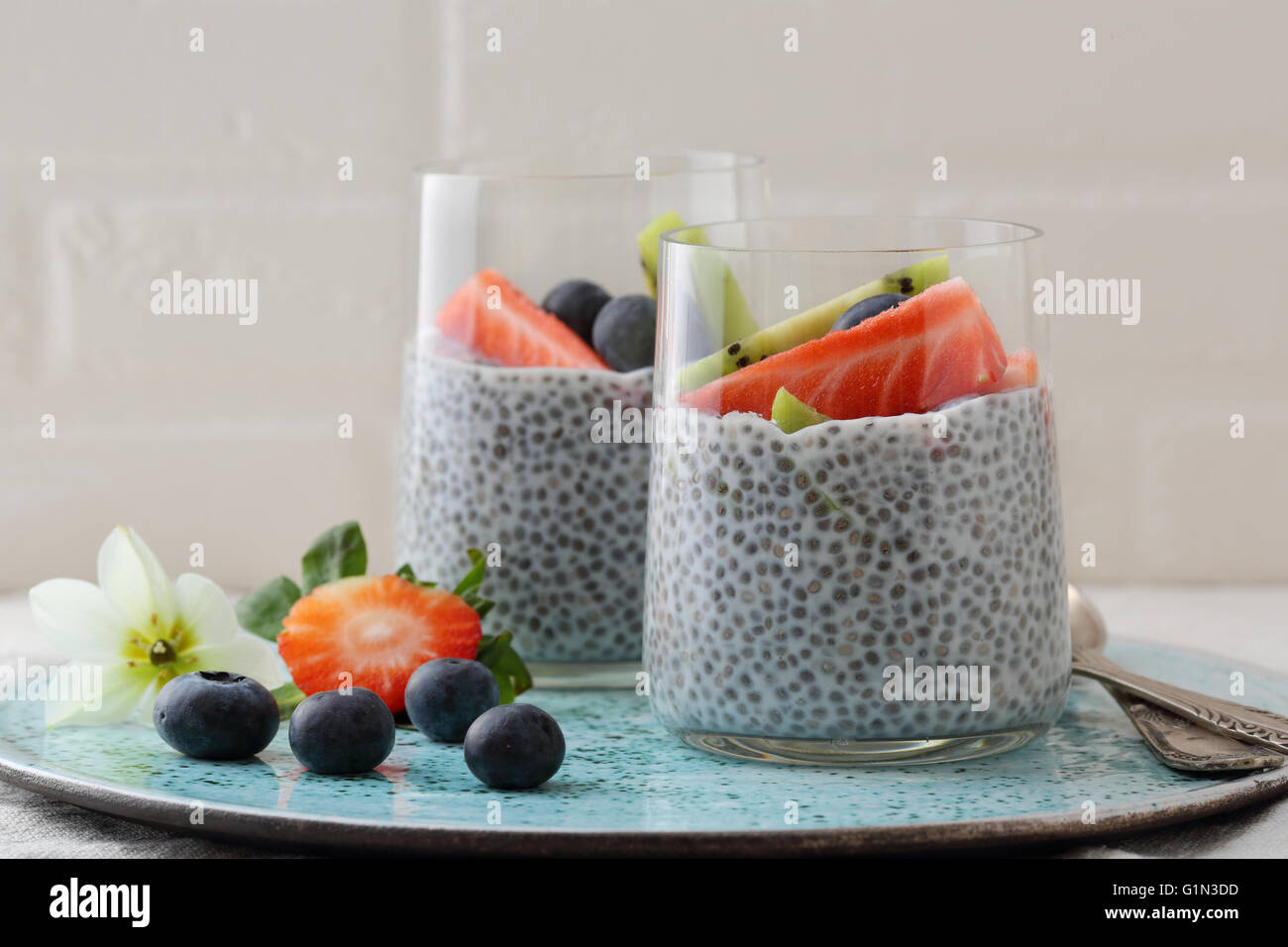 breakfast with chia and fruits, food closeup - Stock Image