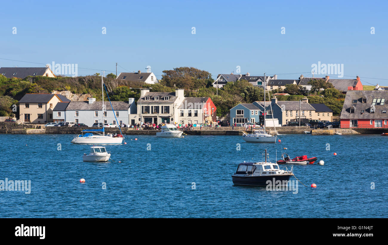 Crookhaven, County Cork, Republic of Ireland.  Eire.  The village seen across the waters of Galley Cove. - Stock Image