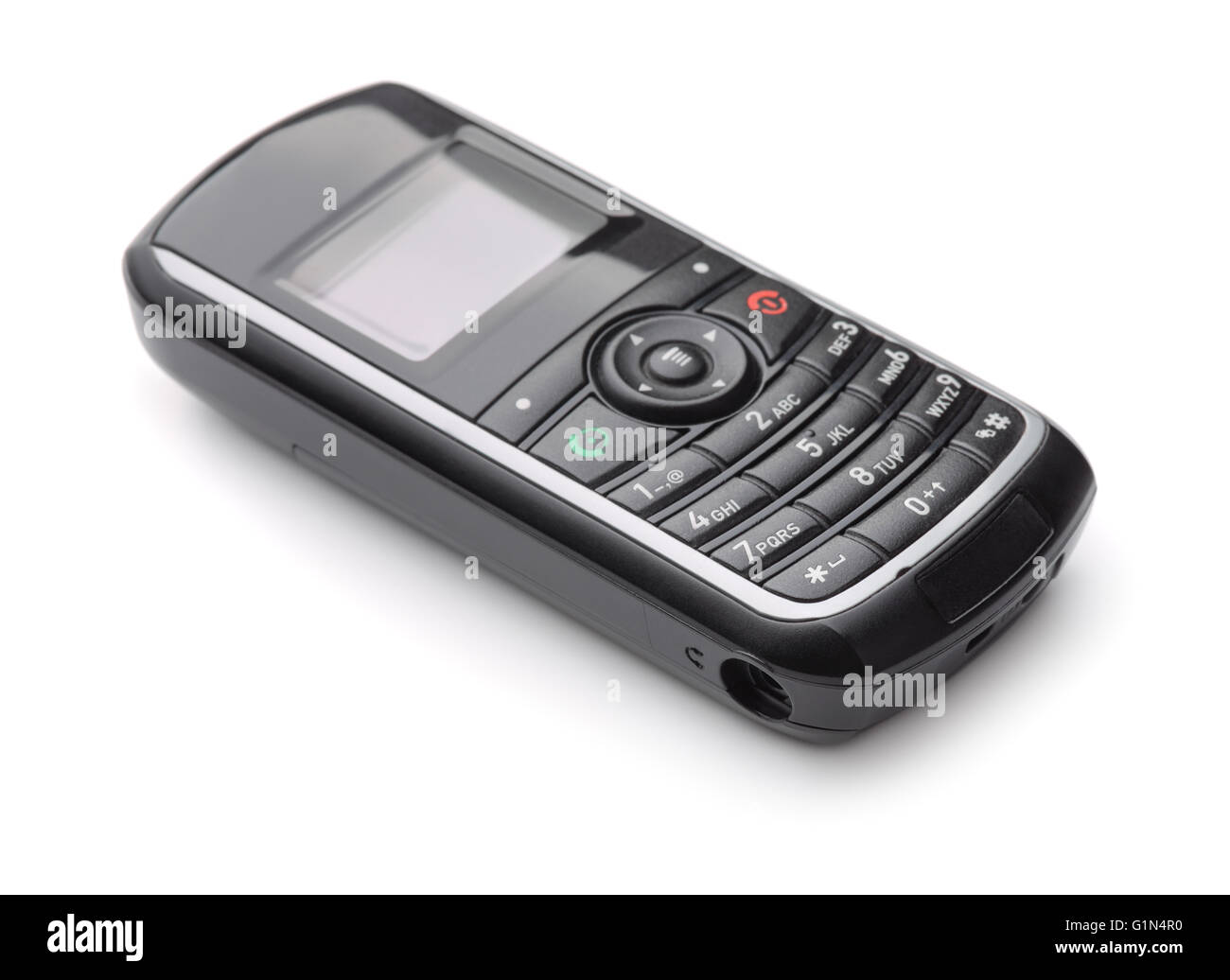 Old cell phone isolated on white - Stock Image