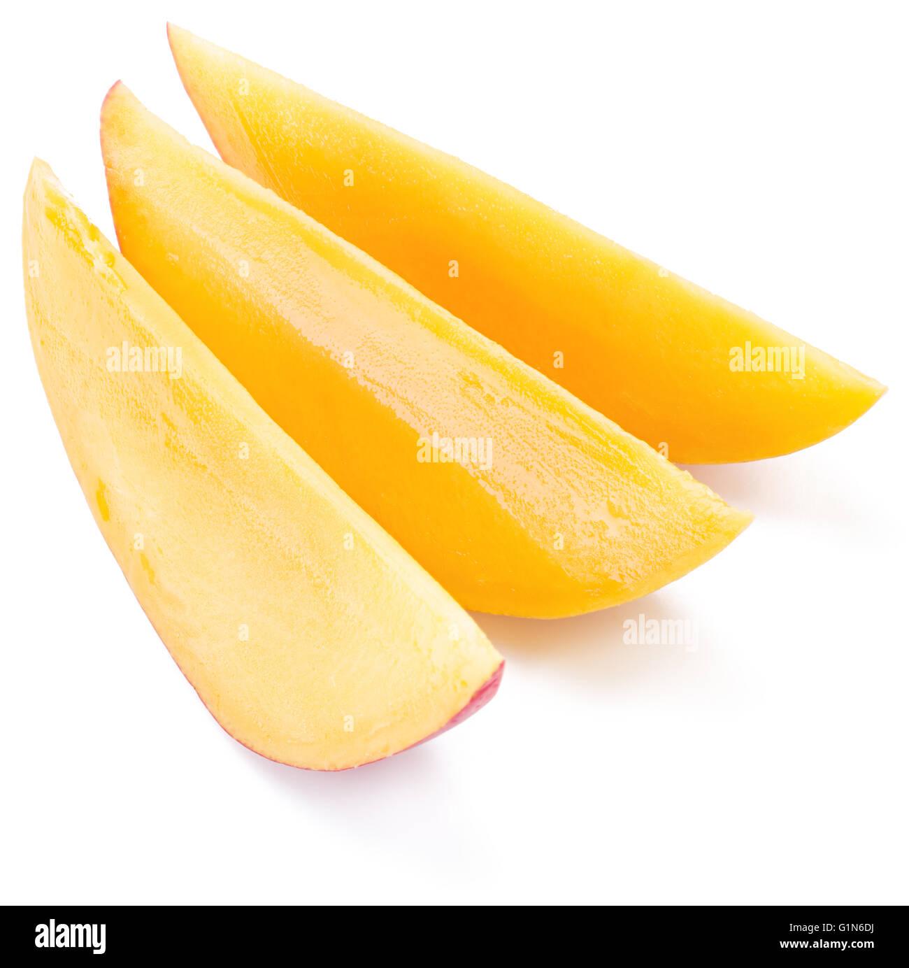 Mango slices. Isolated on a white background. - Stock Image