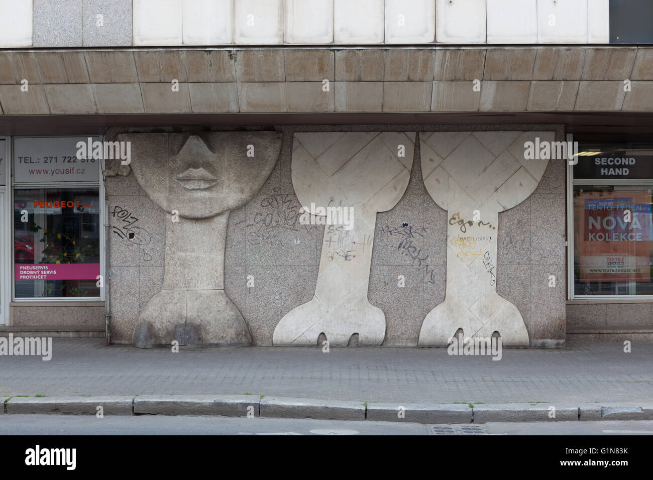 Vintage bas relief on the side of a building - Stock Image