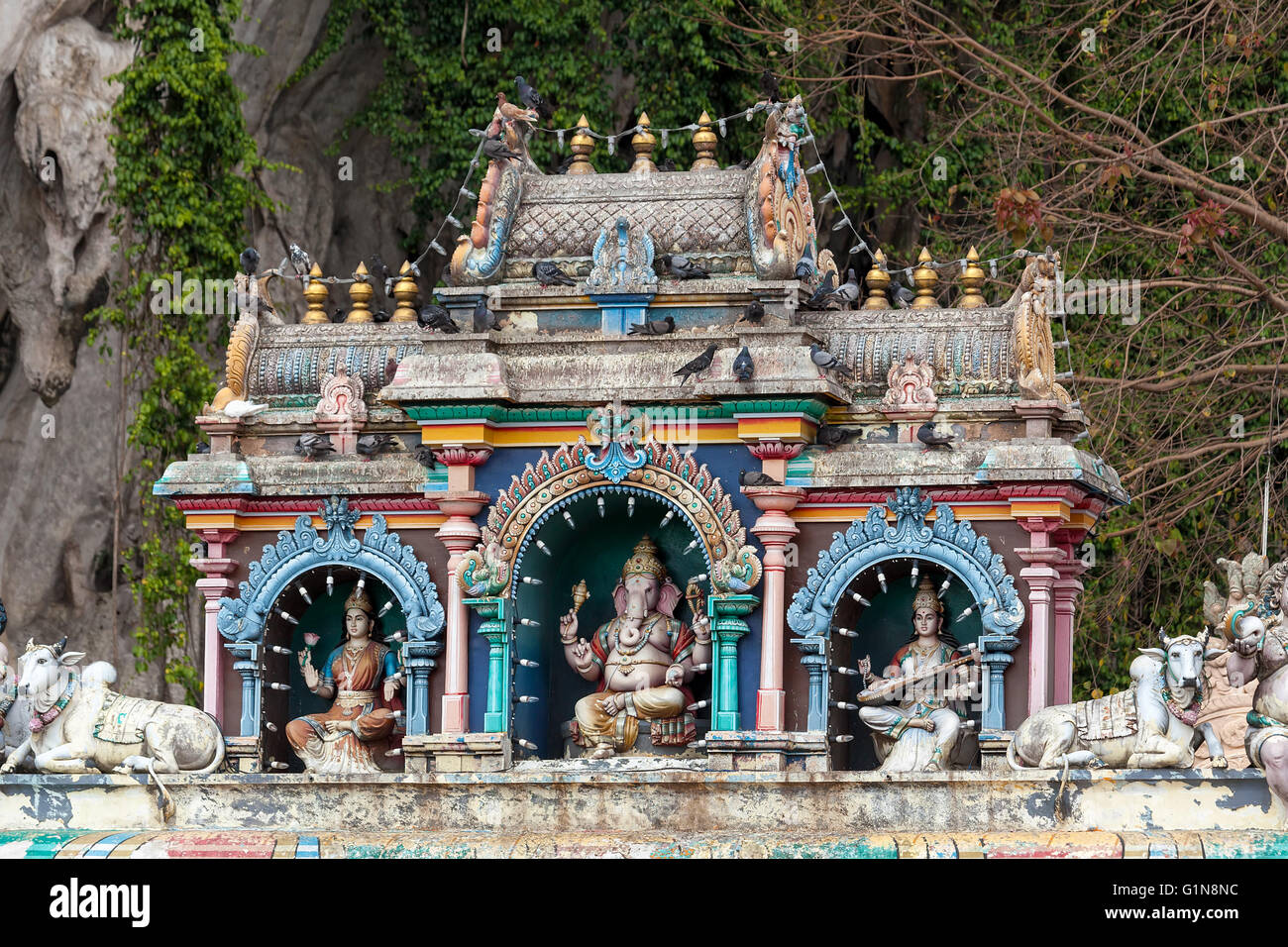Hindu Deities with Ganesh Sculptures Architectural detail at entrance to Batu Caves - Stock Image