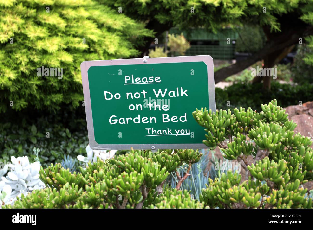 Do Not Walk On The Garden Bed Sign Near The Succulent Garden Stock Photo Alamy