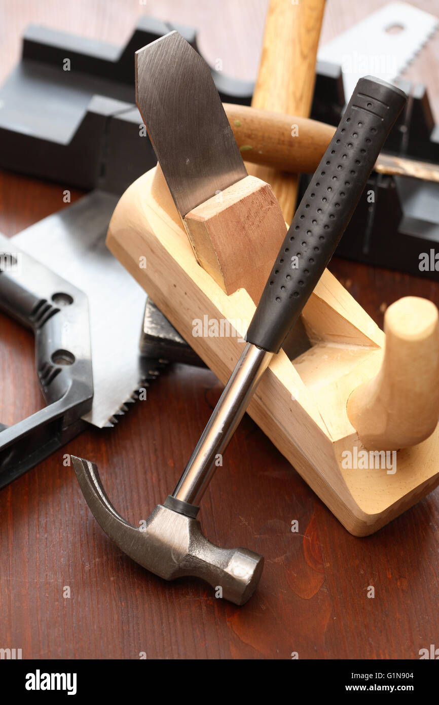 Set of carpenter tools on wooden workbench - Stock Image
