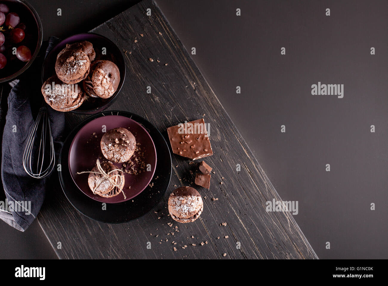 Italian maroni cookies with pieces of chocolate on old wooden background - Stock Image