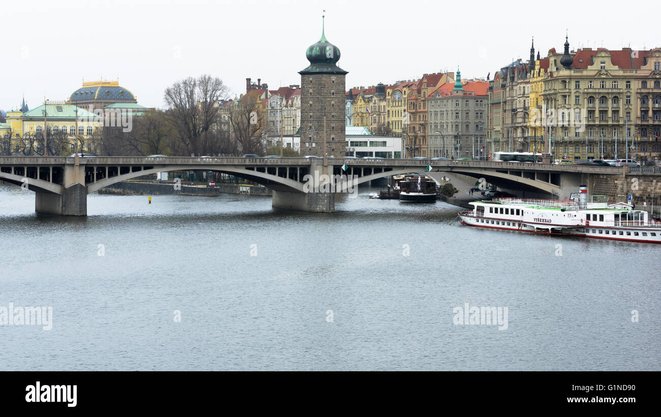 Stone tower with a bridge over the river Vltava in Prague - Stock Image