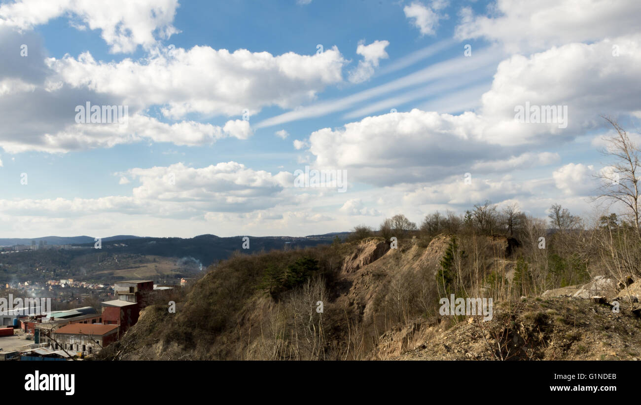 Old quarry with dramatic cloudy scene above - Stock Image