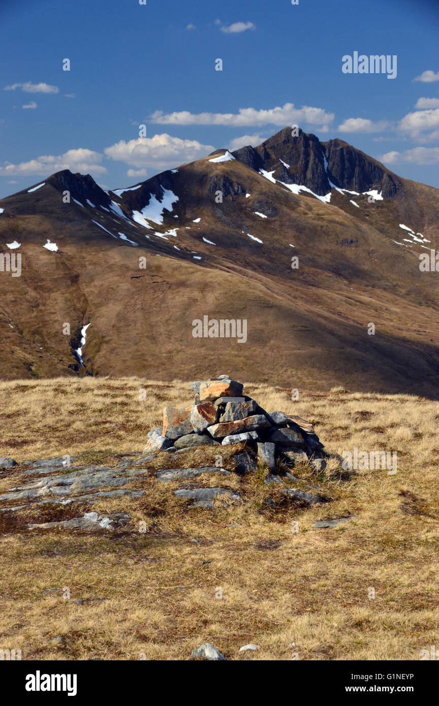 The Pile of Stones on the Summit of the Corbett Am Bathach Looking North to the Munro Ciste Dudh, Glen Shiel, Scottish - Stock Image
