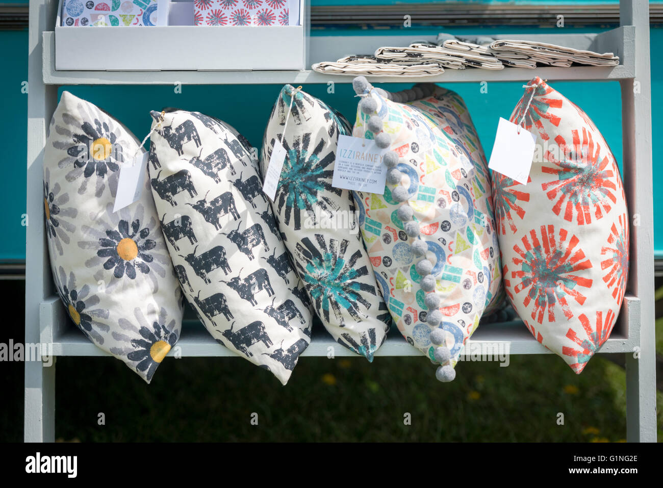 Cushions for sale on a stall - Stock Image