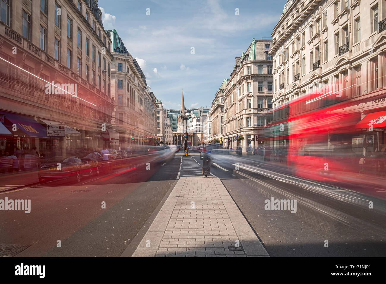 Regent Street with blurred traffic and commuters - Stock Image