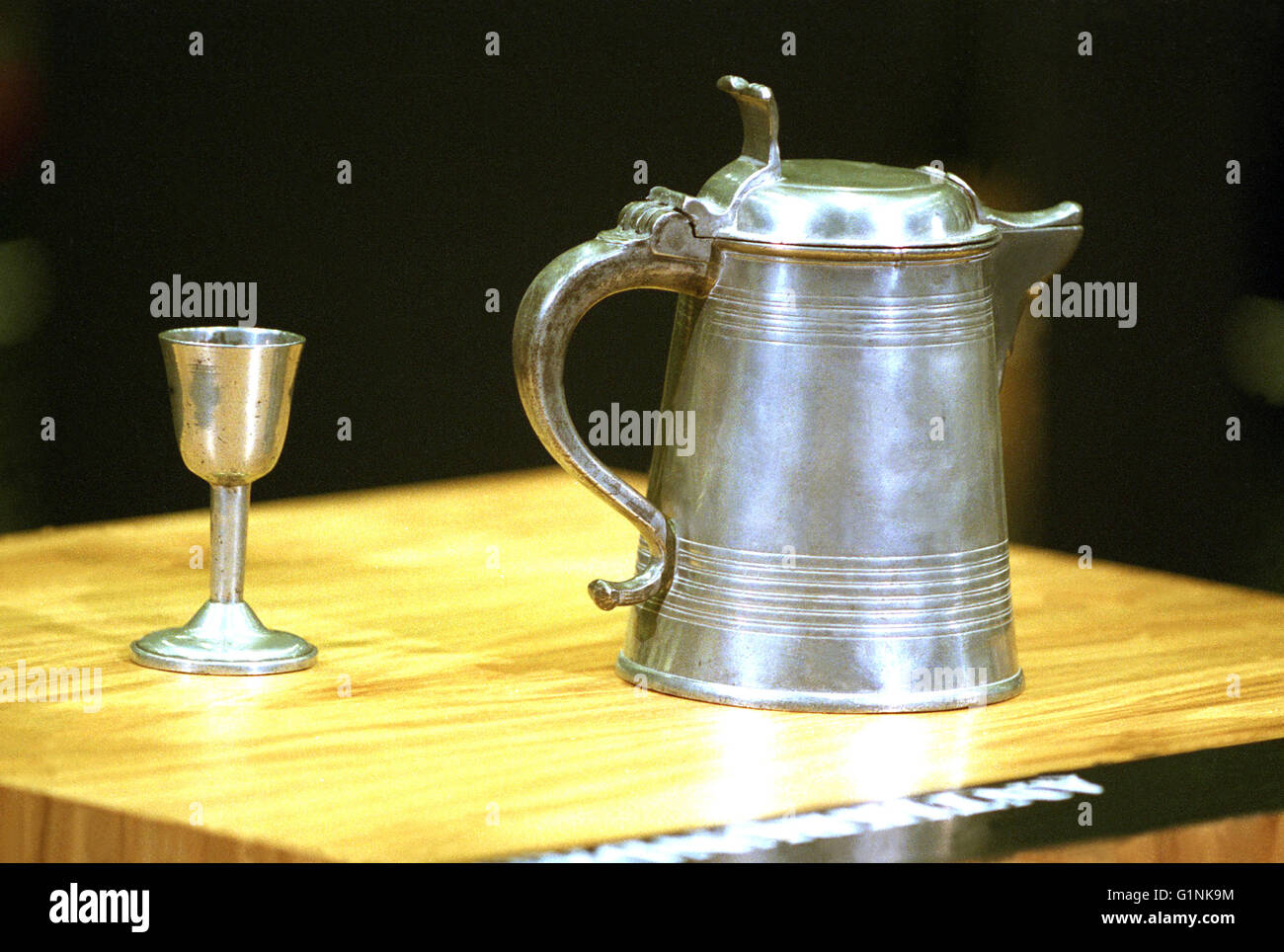 Antique tin pitcher and goblets - Stock Image