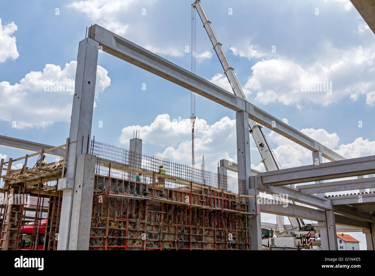 View on building site until workers are assembly a huge mold with reinforcement mesh for concreting. Stock Photo