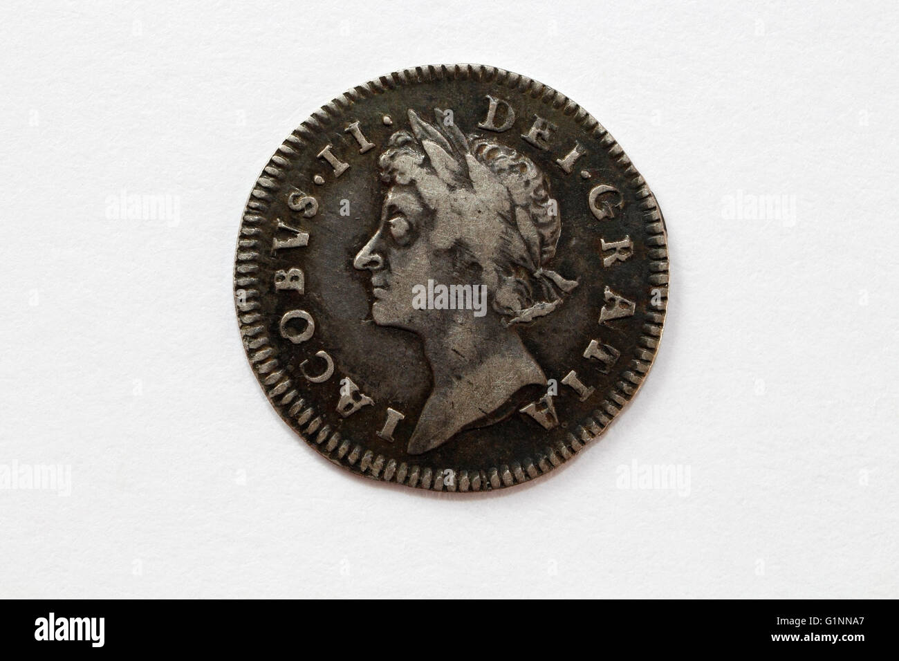 King James 2nd bust on obverse of silver threepence coin - Stock Image