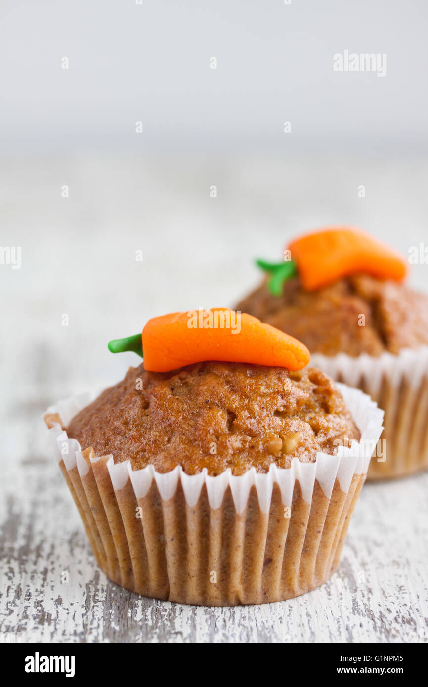 carrot muffin on a wooden background - Stock Image