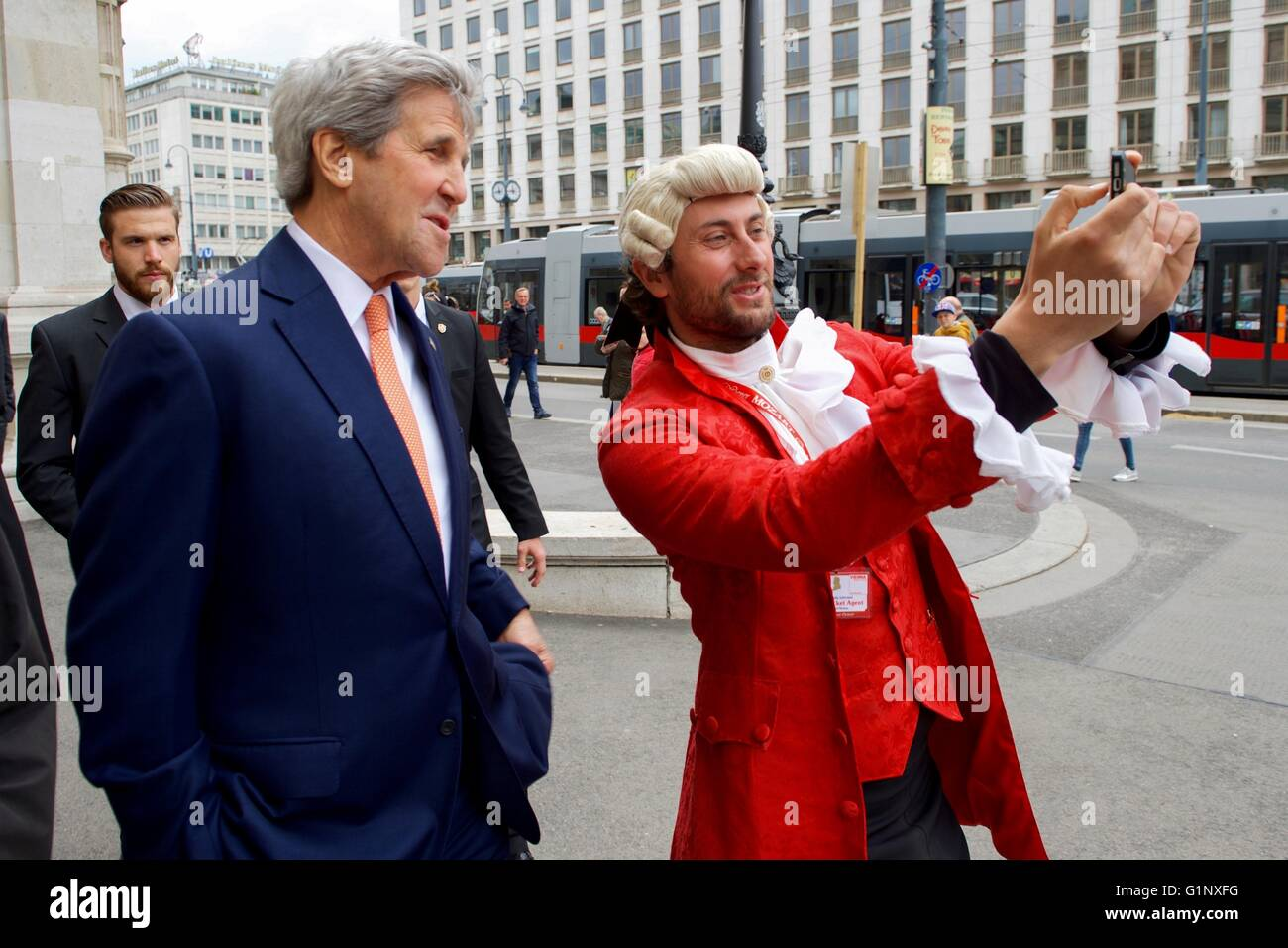 U.S. Secretary of State John Kerry poses for a selfie with a Mozart impersonator as he takes a walk around the Vienna - Stock Image