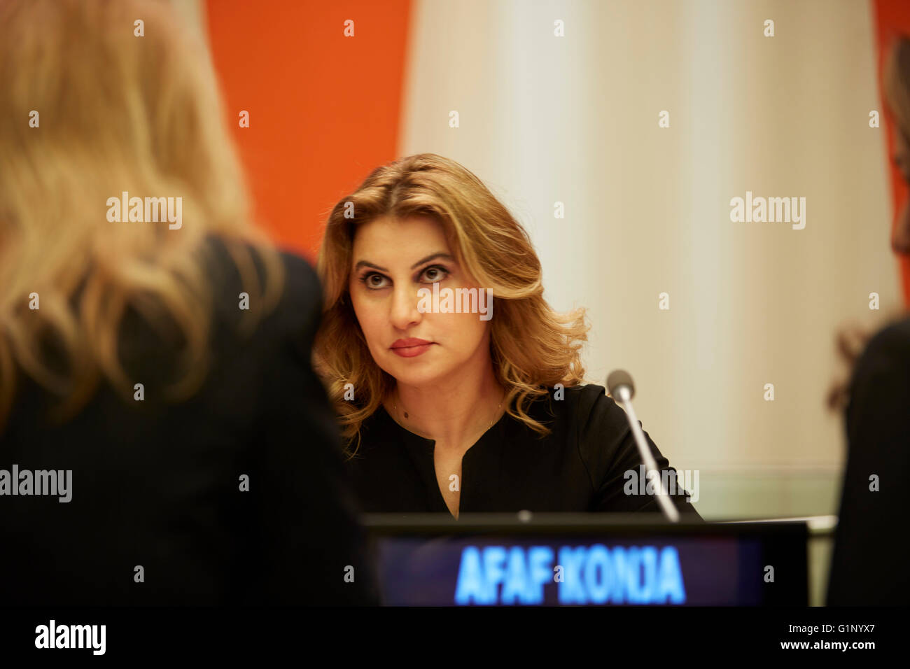 New York, United States. 16th May, 2016. Moderator Afaf Konja listens to participant during United Nations HQ International - Stock Image