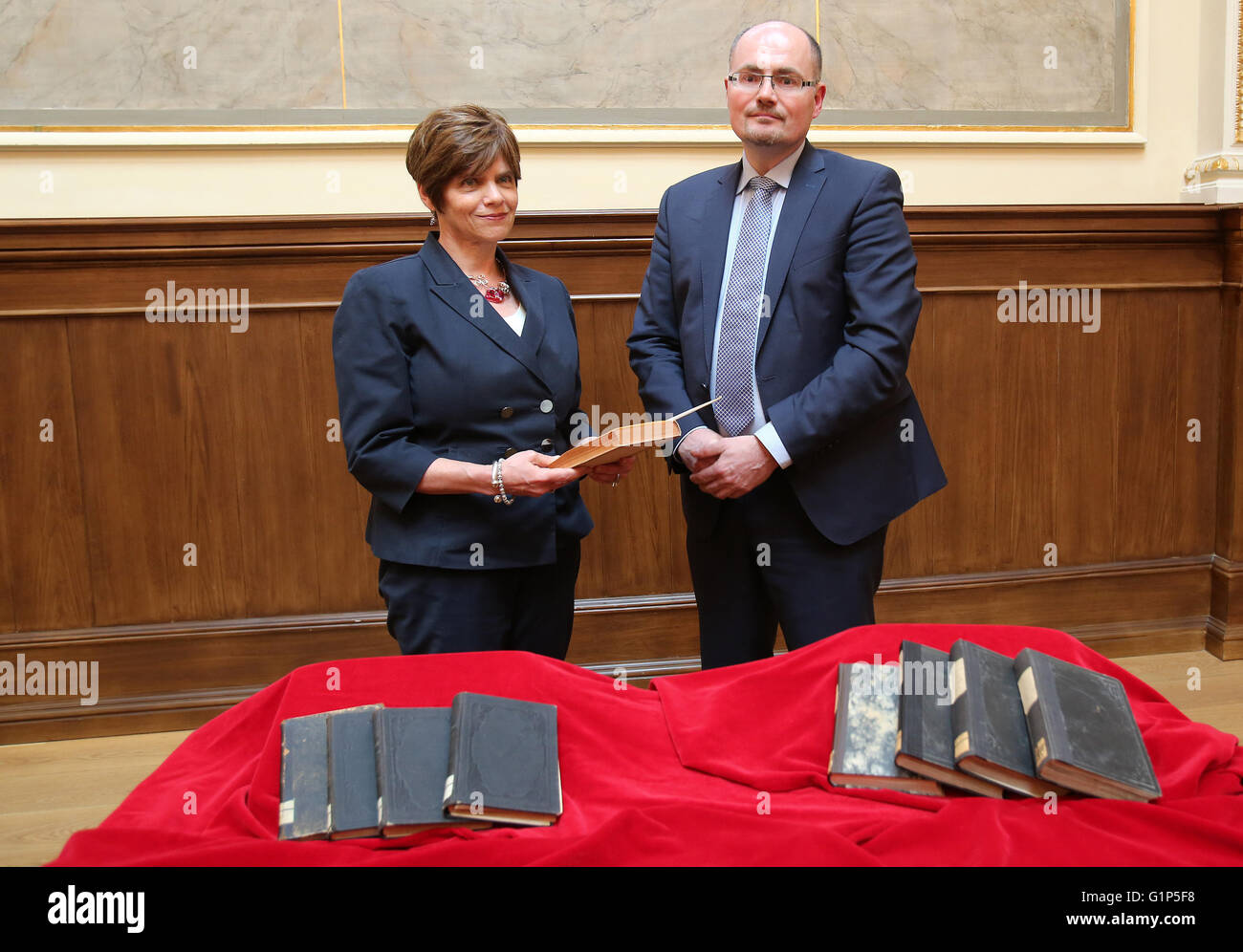 Rostock, Germany. 18th May, 2016. Library head Robert Zepf (R) hands over stolen books from the inventory of the Stock Photo