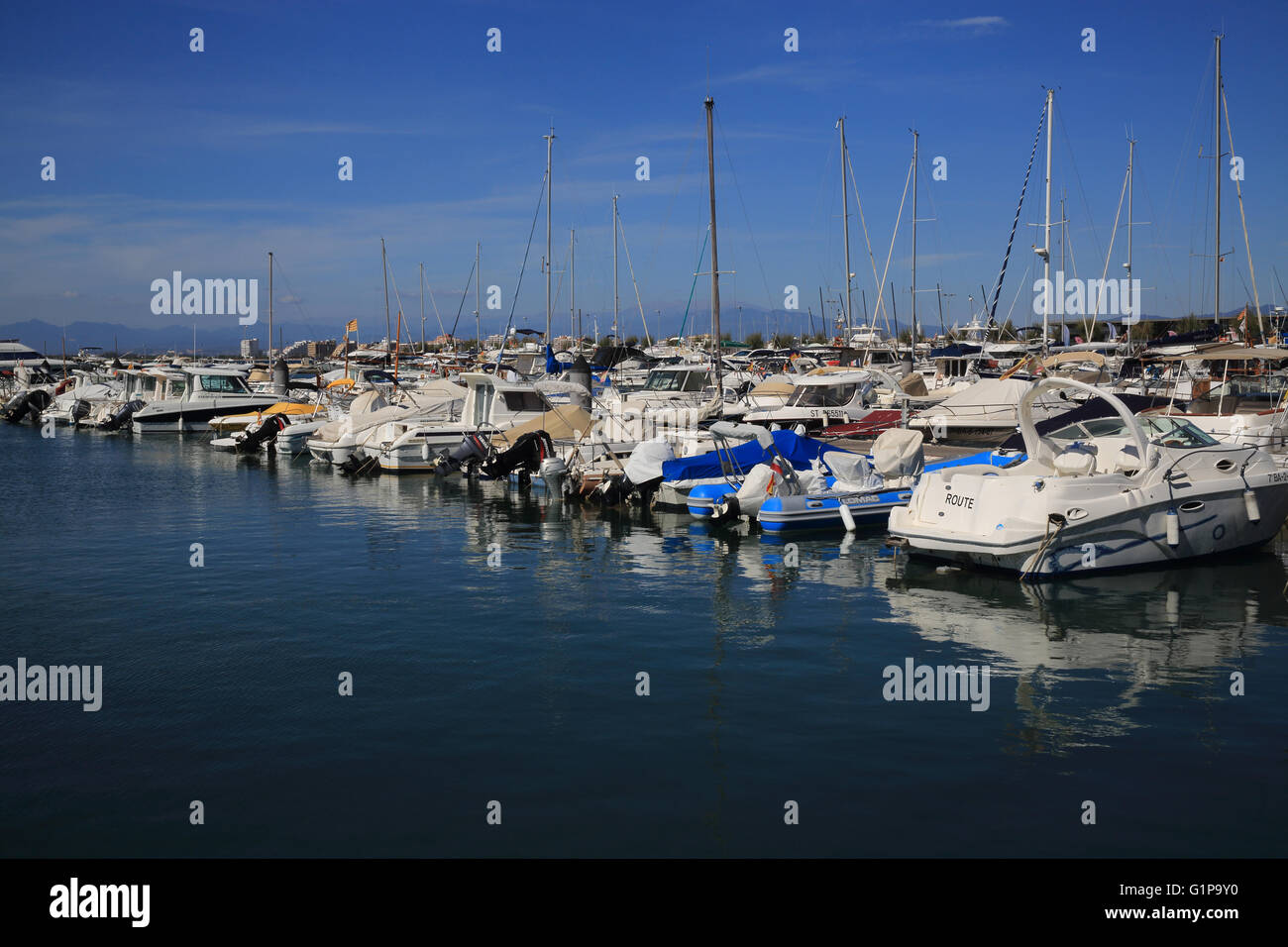 The pretty marina in the coastal town of Roses, in the province of Girona, in Catalonia, on the the Costa Brava, - Stock Image