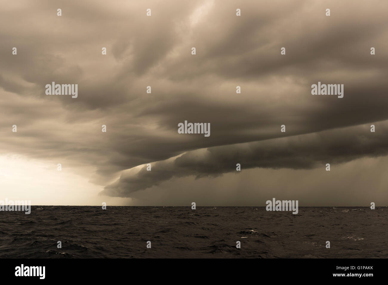 Distinctive line of black clouds,  frontal clouds signalling a wind change seen offshore in the Tasman Sea. - Stock Image
