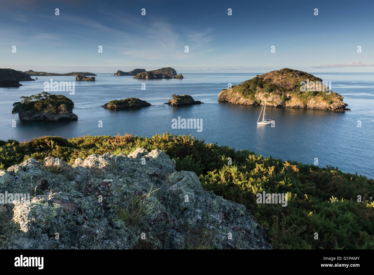 Early morning light, topshot of a yacht anchored on its own amongst the small islands to the west of Great Barrier - Stock Image