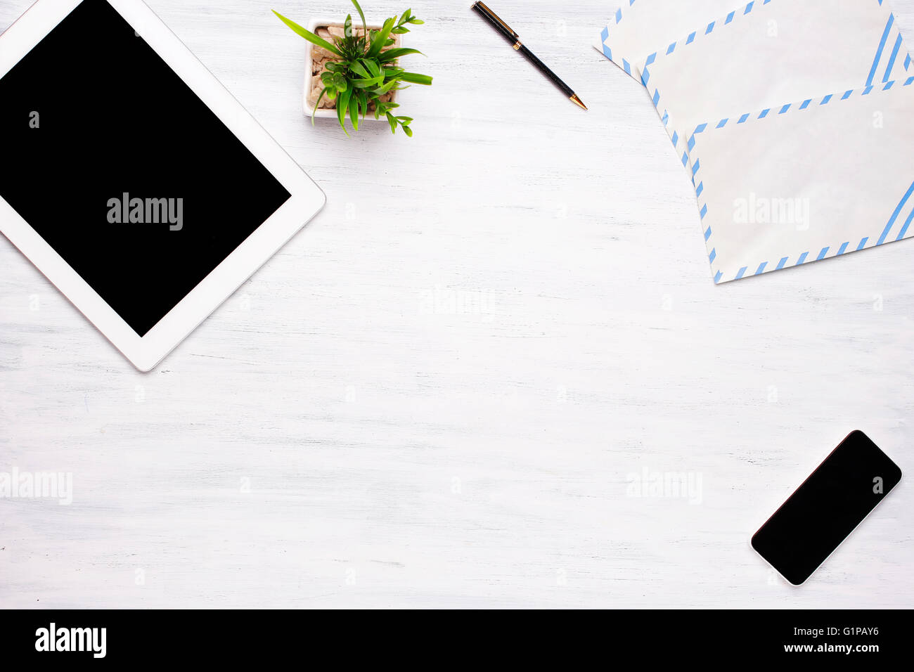 home office items. Top View Of A Tablet Computer, Smartphone And Office Items On White Wooden Desk. Home Concept. Business Lifestyle. R