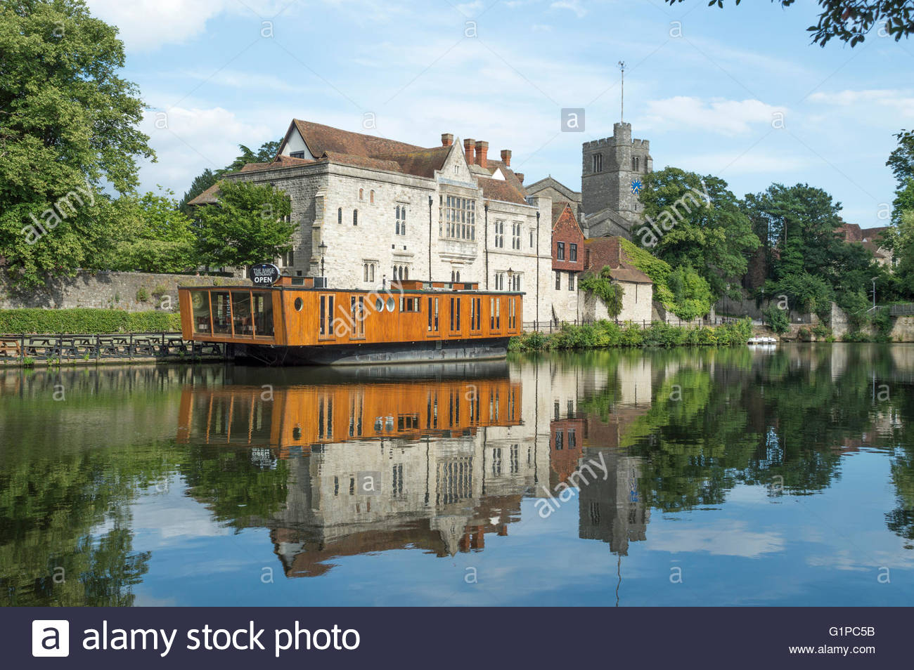 View across the River Medway to the opposite bank showing The Barge Restaurant  and it's reflections in the - Stock Image