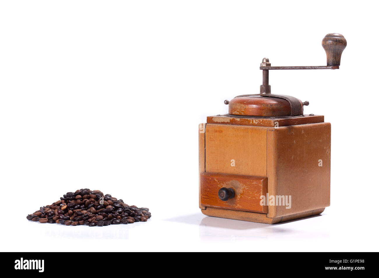 Old coffee mill with beans , isolated on white background - Stock Image