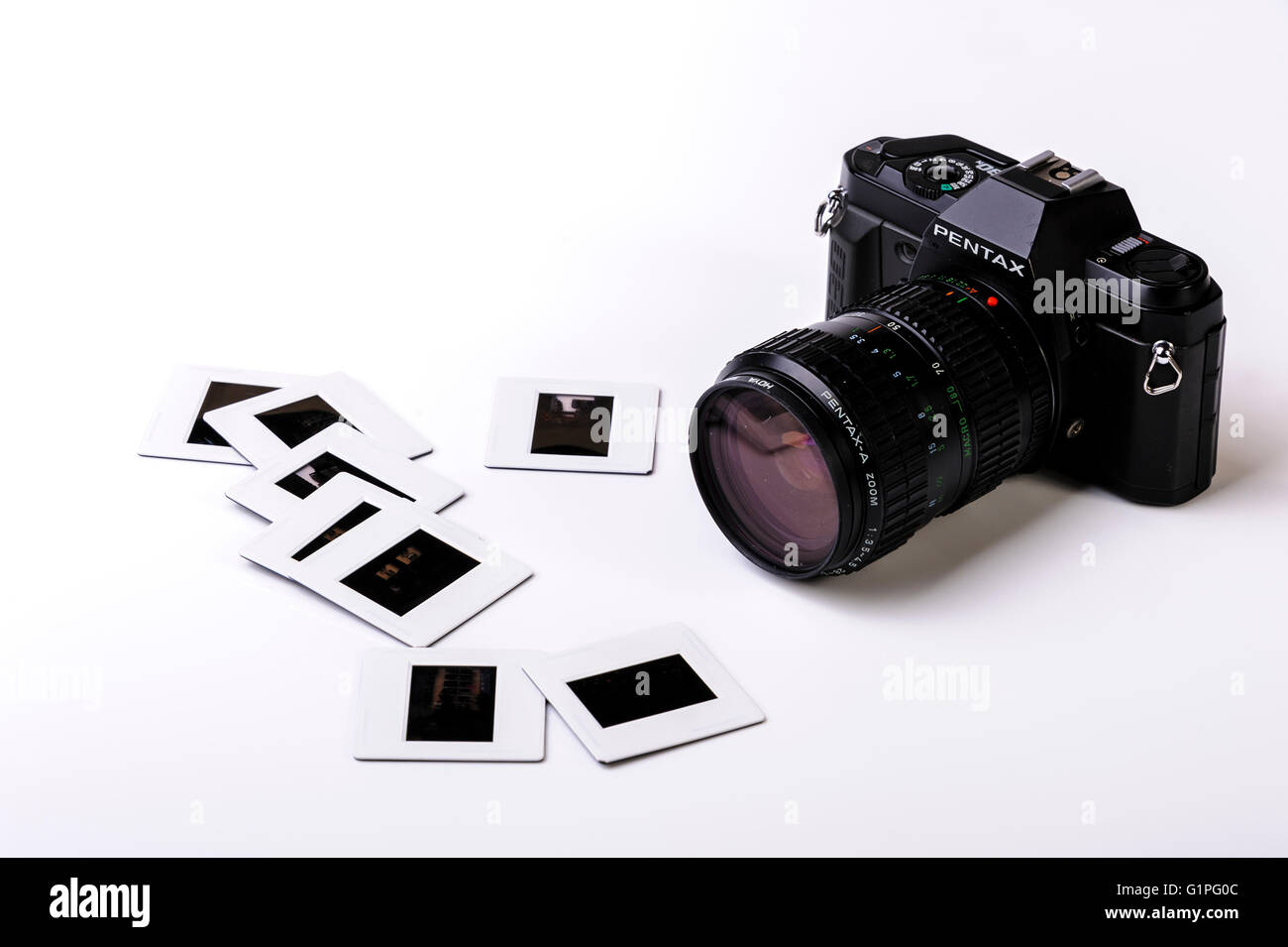 Old 35mm film camera and some mounted transparencies. - Stock Image