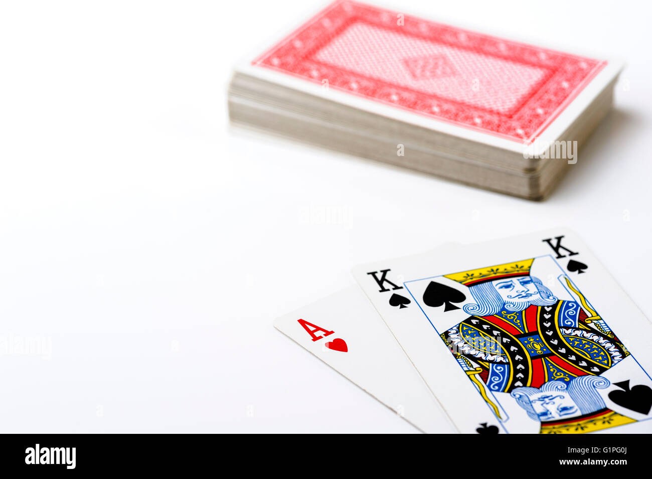 Ace King and stack of playing cards. - Stock Image