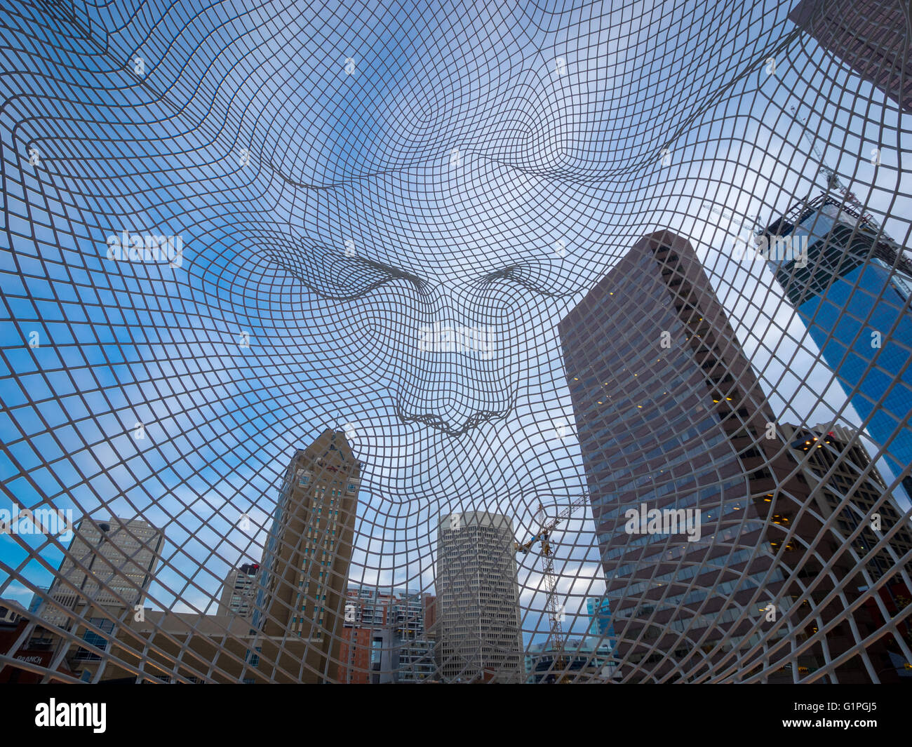 Downtown Calgary, Alberta, Canada, skyscrapers as seen from within Jaume Plensa's Wonderland sculpture. - Stock Image
