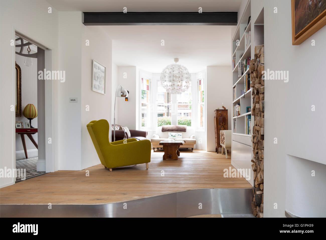 Oblique wide shot of living room. Private House, London, United Kingdom. Architect: Scenario Architecture, 2016. - Stock Image