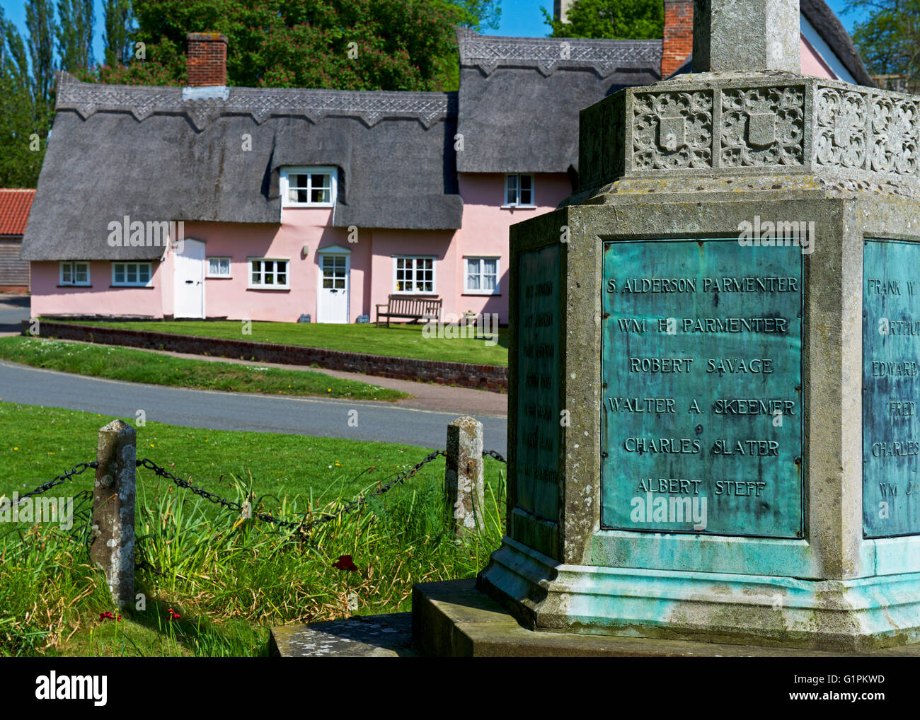 War memorial and almshouses, in the village of Cavendish, Suffolk, England UK - Stock Image