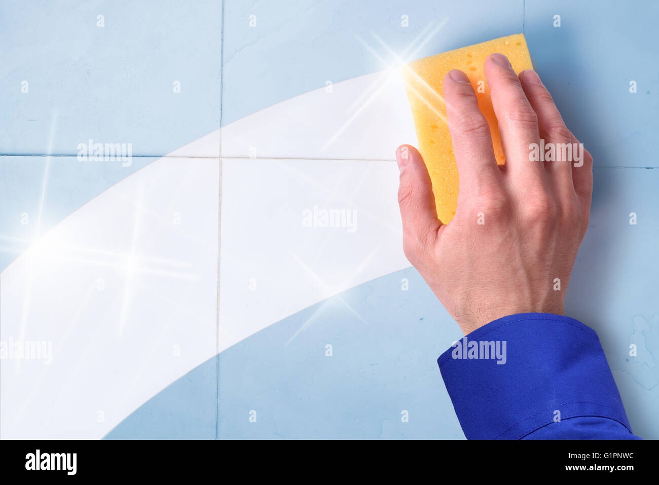 Concept of professional cleaning employee with blue tiles background and clean trace - Stock Image