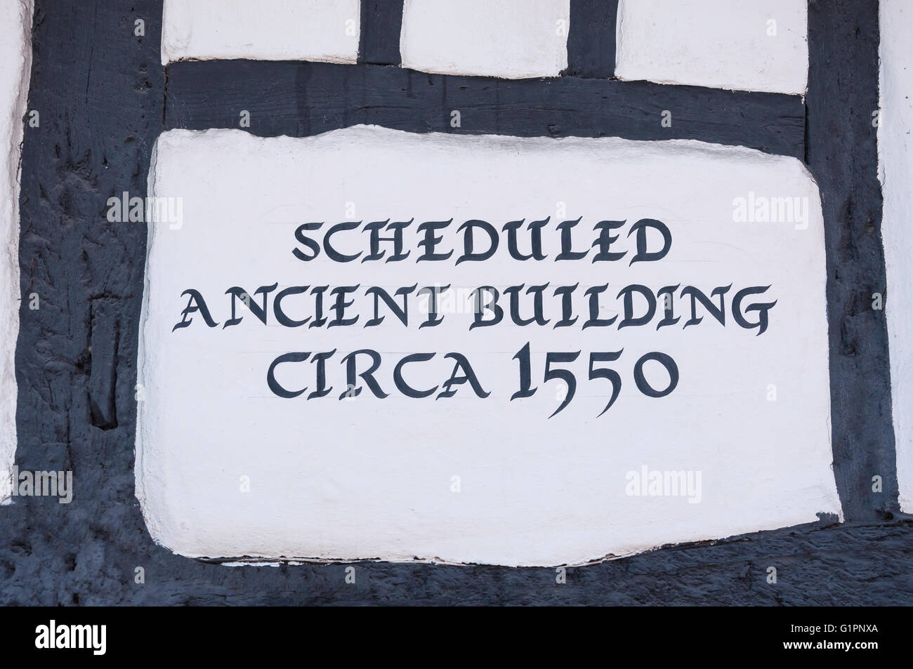 Ancient building sign on 16th century 'The Thatch' pub, High Street, Thame, Oxfordshire, England, United - Stock Image