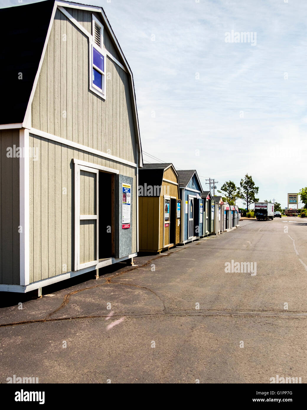 Portable storage sheds for sale in the parking lot of a ...