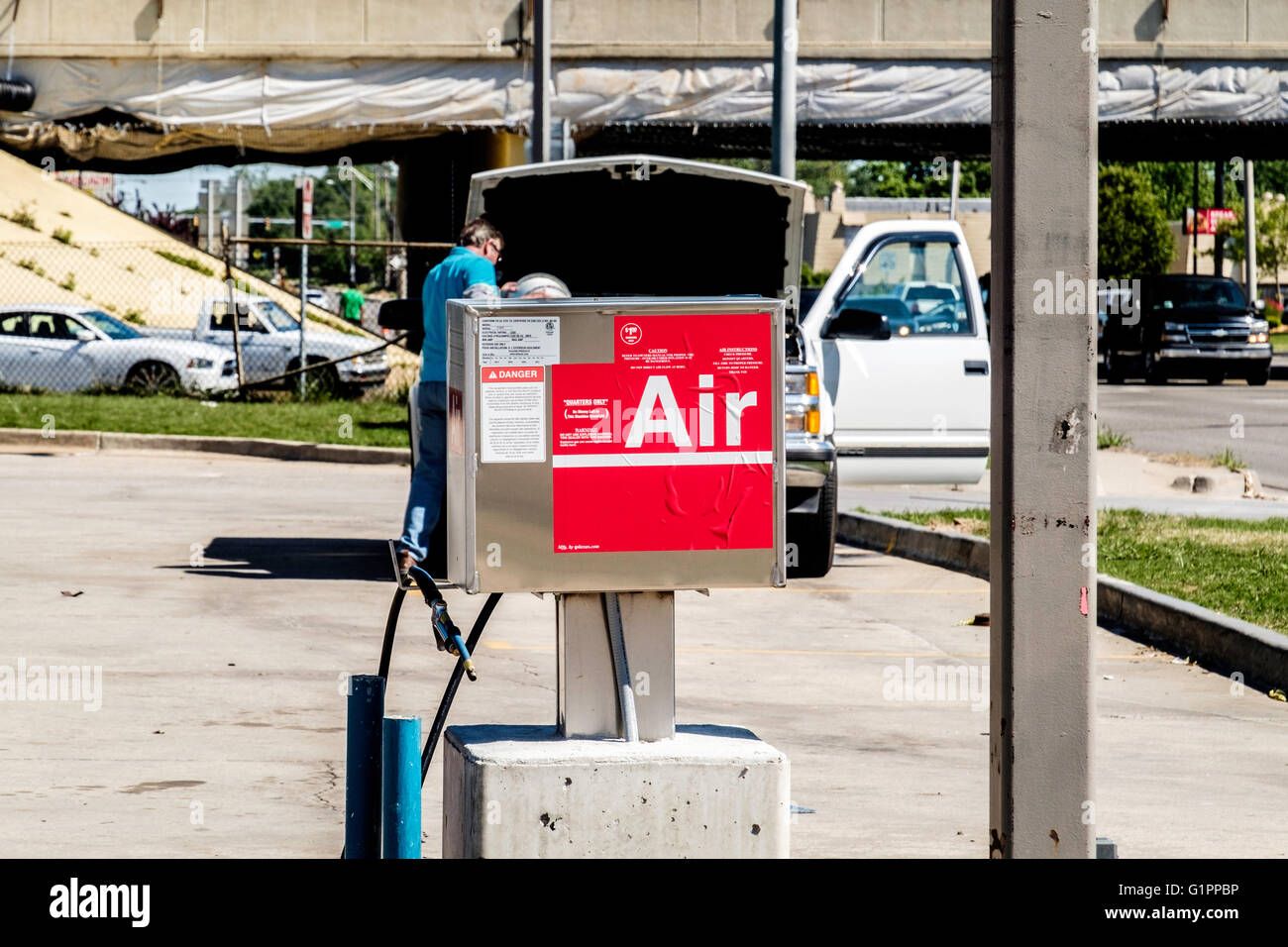 A Coin Operated Air Pump To Air Up Tires In Front Of A Gasoline