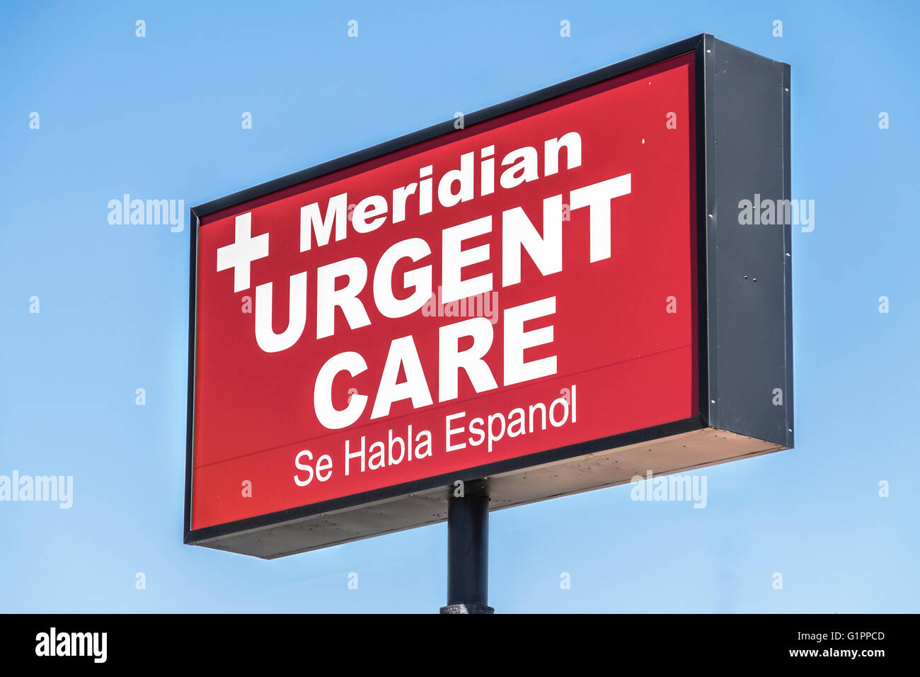 A pole sign advertising urgent medical care. USA. 2305 N. Meridian. - Stock Image