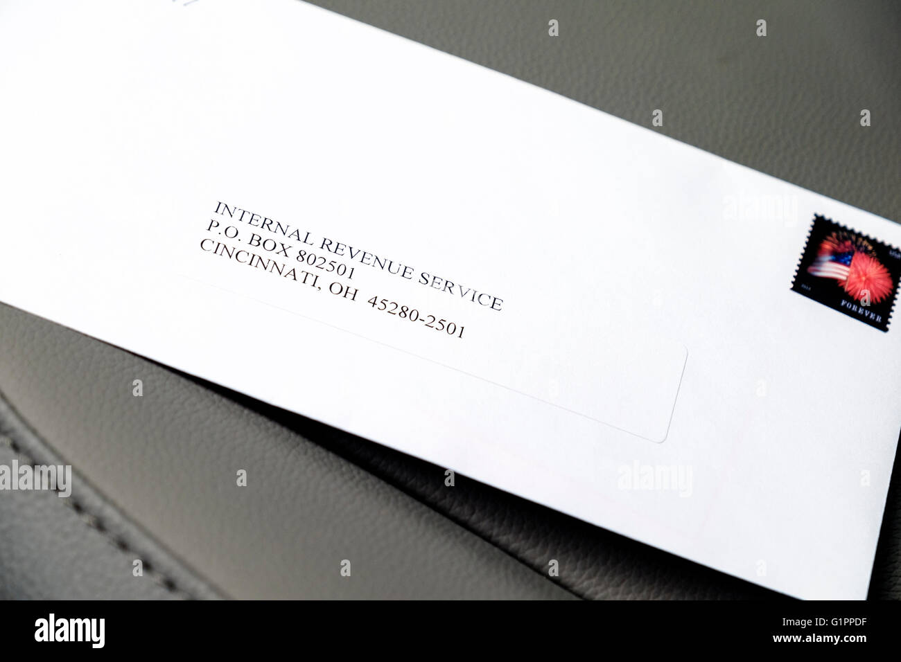 An envelope with the Internal Revenue Service address and stamp. Stock Photo