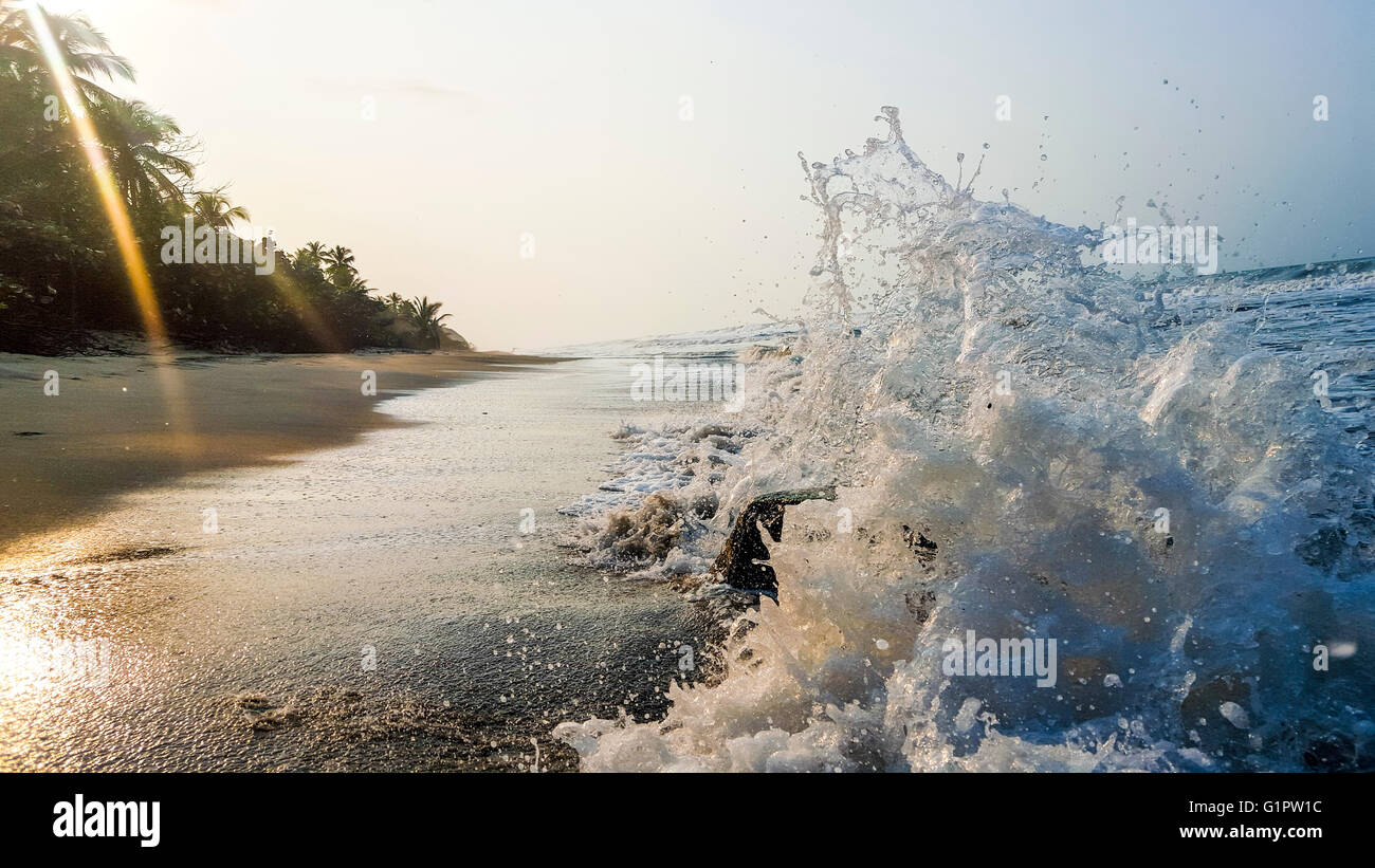 gentle Waves break on on the beach in Cartagena, Colombia - Stock Image