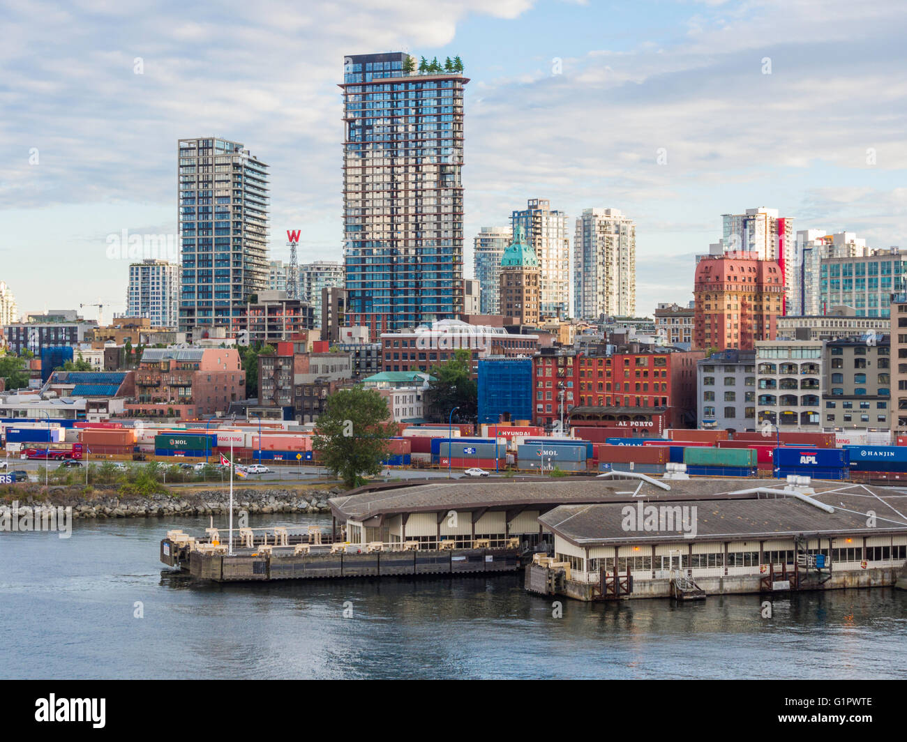 Vancouver's downtown eastside, seen from Vancouver Cruise Terminal at Canada Place.  Woodwards 'W' and domed 'Sun' Stock Photo