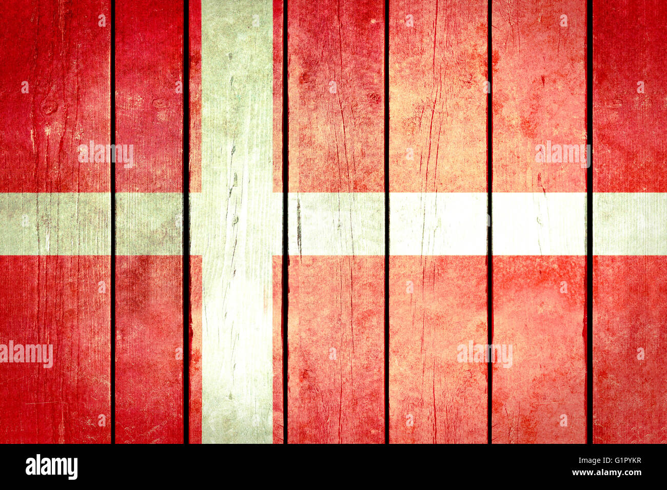 Denmark wooden grunge flag. Denmark flag painted on the old wooden planks. Vintage retro picture from my collection - Stock Image