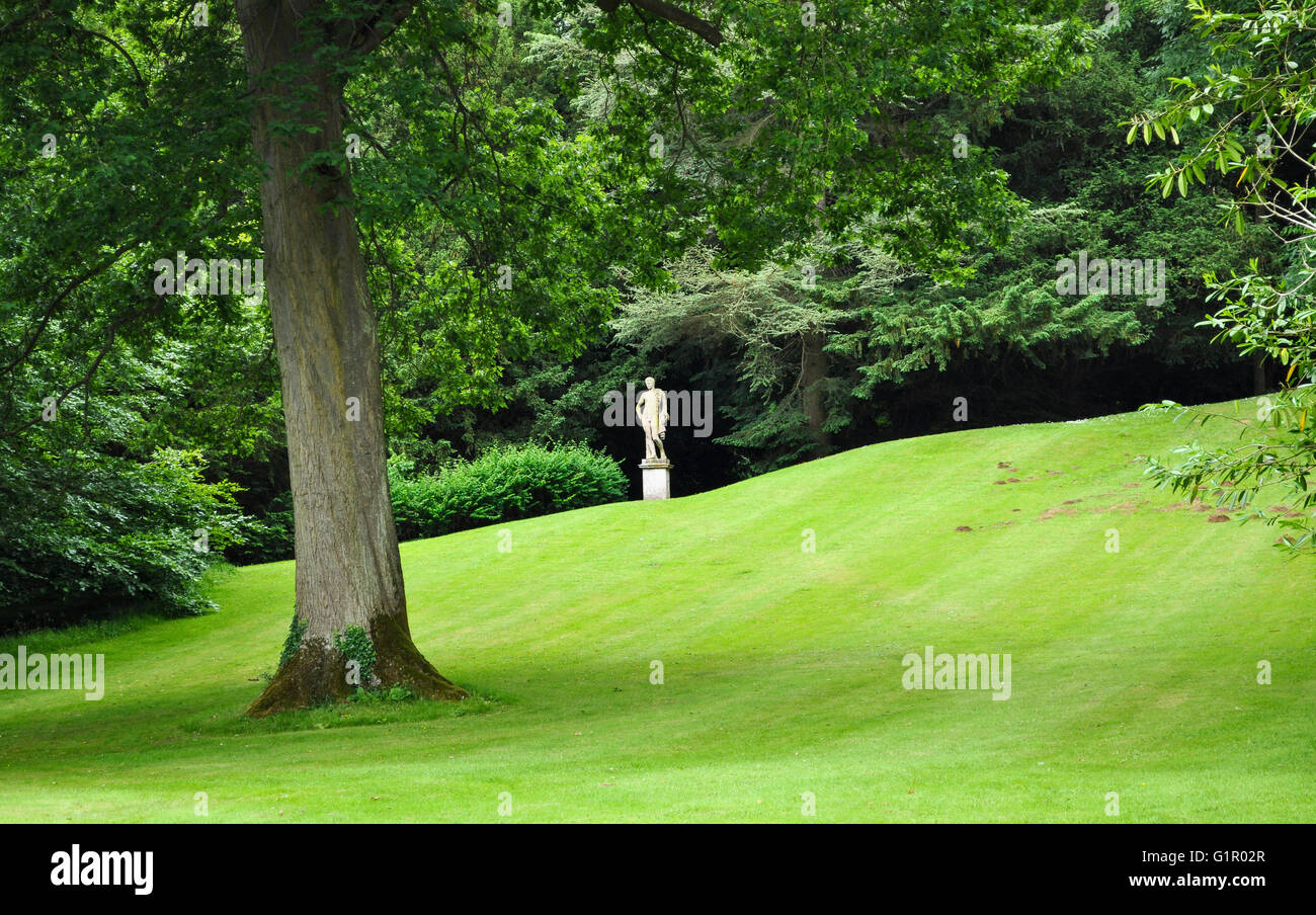 Statue and rolling grass in the fabulous grounds of Rousham House, Oxfordshire, UK. - Stock Image